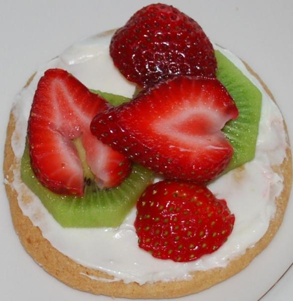 Fresh fruit on cream cheese covered cookie.  Yum....]